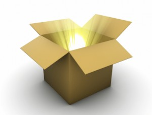Light shining out of a cardboard box signifying enlightening package of extra lessons